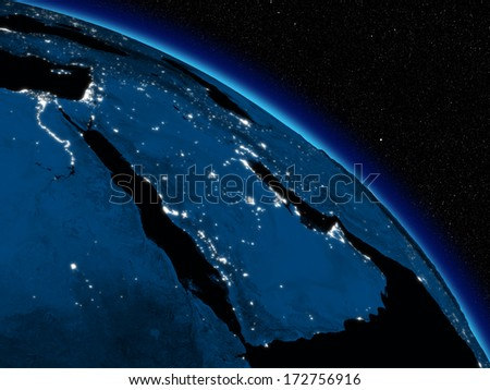 Arabian peninsula at night on planet Earth viewed from space. Highly detailed planet surface with city lights. Elements of this image furnished by NASA. - stock photo