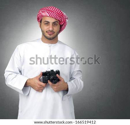 Arabian Photographer with his cam  - stock photo