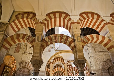 Arabic arches hallway in Cordoba's mosque. Spain  - stock photo