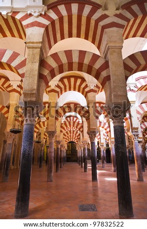Arabic arches hallway in Corodoba's mosque. Spain - stock photo