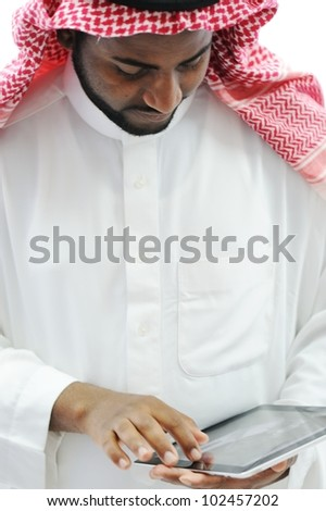 Arabic business man with tablet at office - stock photo