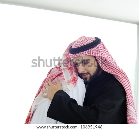 Arabic business people hugging each other - stock photo