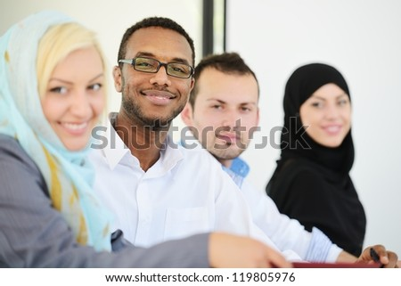 Arabic business people sitting in a row at office (selective focus) - stock photo