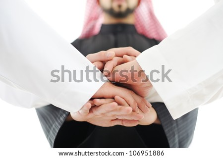 Arabic business team showing unity with Cooperation Council - stock photo