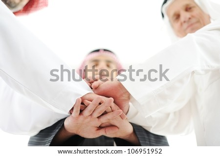 Arabic business team showing unity with their hands together - stock photo