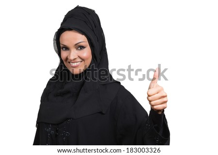 Arabic business woman,smiling and showing a thumb up, isolated on white background. - stock photo