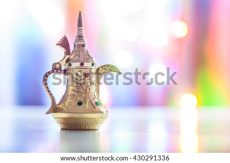 Arabic coffee pot in colorful background. Ramadan, Eid concept. - stock photo