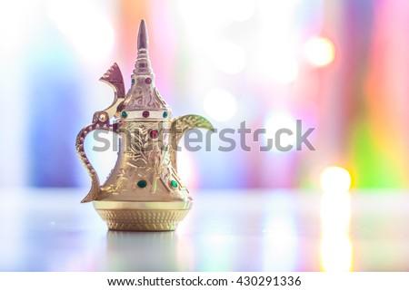Arabic coffee pot in colorful background. Ramadan, Eid concept. - stock photo