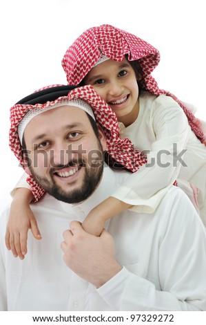Arabic family, father piggybacking son - stock photo