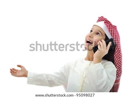 Arabic kid playing on phone in Ramadan - stock photo
