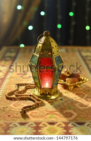Arabic lamp with dates and rosary - stock photo