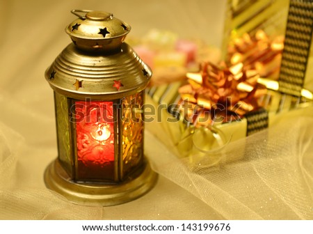 Arabic lantern with gifts at background - stock photo