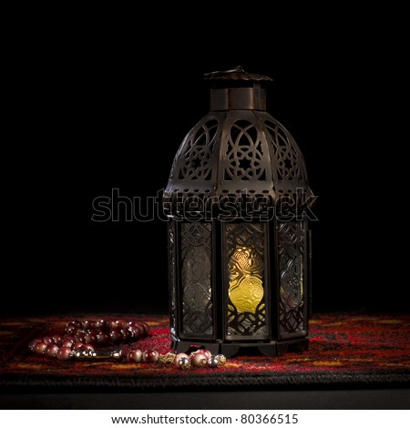 Arabic lantern with wooden rosary - stock photo