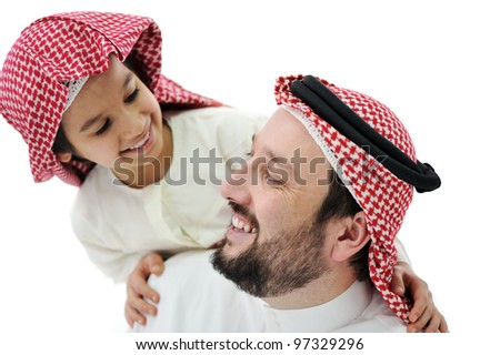 Arabic Muslim father and son - stock photo