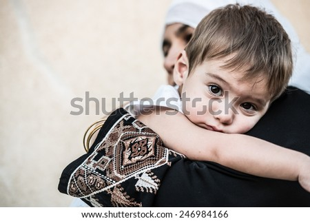 Arabic Muslim Middle Eastern woman with little son - stock photo