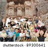 Arabic Muslim portrait of very big family group with many members, 3 generations - stock photo