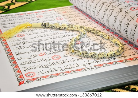 Arabic Ramadan Fasting Aya From Quran And Rosary - stock photo