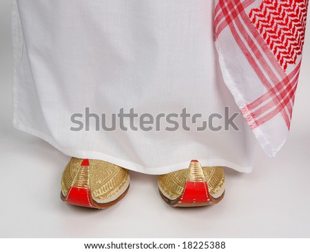 Arabic slippers and Aladdin on white background. - stock photo