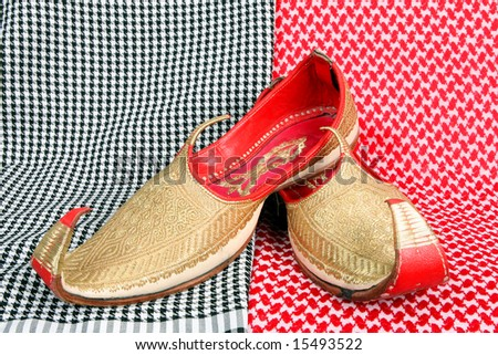 Arabic slippers on arabic background. - stock photo