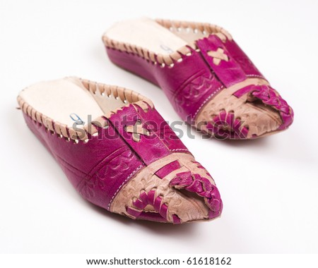 Arabic slippers on white background