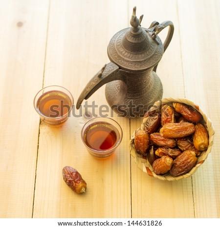 Arabic tea and dates - stock photo