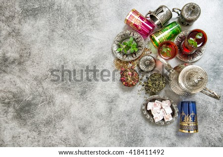 Arabic tea table setting. Herbal tea. Green tea. Tea tradition. Oriental hospitality. Ramadan kareem. Muslim holidays. Islam - stock photo