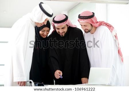 Arabic team work - stock photo