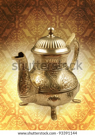 arabic teapot on concept golden damask background - stock photo
