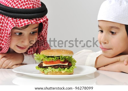 Arabic two little boys with big Burger - stock photo