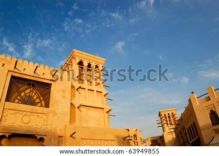 Arabic wind tower during sunset, Dubai, UAE - stock photo