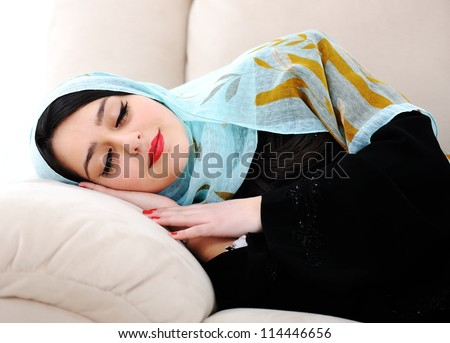 Arabic woman sleeping on sofa - stock photo