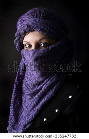 Arabic Woman warrior portrait against a dark background - stock photo