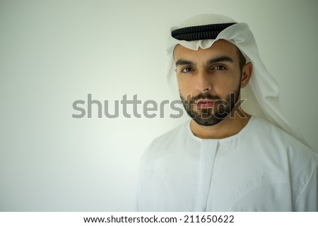 Arabic young businessman posing - stock photo
