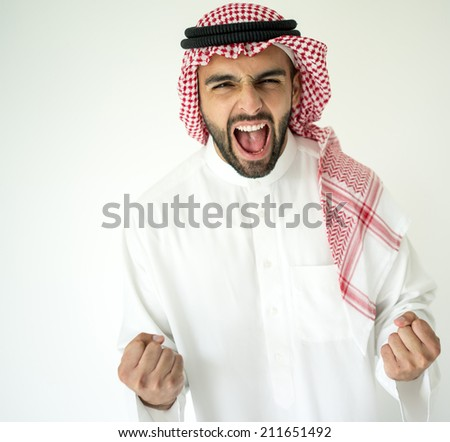Arabic young businessman posing on red wall yelling celebrating - stock photo