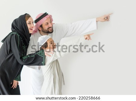 Arabic young family pointing - stock photo