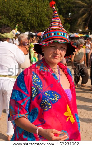 ARAMBOL, GOA, INDIA - FEB. 5: Woman in clown cap and bright clothes at the annual festival of Freaks on FEB. 5, 2013 in Arambol beach, Goa, India