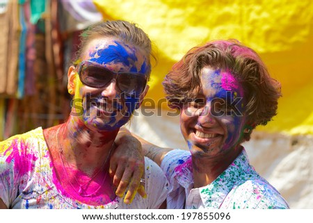 ARAMBOL, GOA, INDIA - MARCH 17: Young women celebrates Holi festival in Arambol Main Street, GOA, India March 17, 2014. It's a religious spring holiday and also known as Festival of Colours. - stock photo