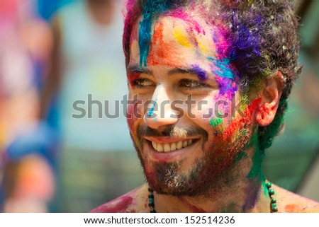 ARAMBOL, GOA - MARCH 27: Unidentified man celebrates Holi festival in Arambol Main Street, GOA, India on March 27, 2013. It's a religious spring holiday and also known as Festival of Colours.  - stock photo
