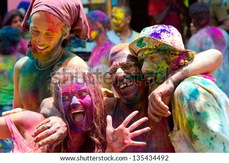 ARAMBOL, GOA - MARCH 27: Unidentified people celebrates Holi festival in Arambol Main Street, GOA, India on March 27, 2013. It's a religious spring holiday and also known as Festival of Colours. - stock photo