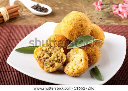 Arancini rice and meat on complex background - stock photo
