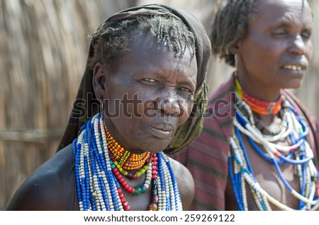 ARBORE, ETHIOPIA, 13 AUGUST:unidentified old woman from Arbore tribe in Arbore, Ethiopia, on 13 august 2014. Arbore women use a lot of bead necklaces as personal decoration - stock photo