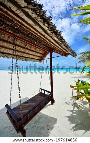Arbour on the tropical beach - stock photo