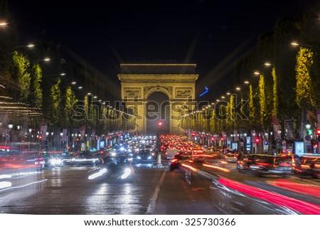Arc de Triomphe at night, Paris France - stock photo