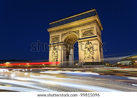 Arc de Triomphe by night with car lights - stock photo