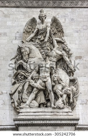 Arc de Triomphe de l'Etoile on Charles de Gaulle Place, Paris, France. Main sculptural groups on each of the Arc's pillars. Arc is one of the most famous monuments in Paris. - stock photo