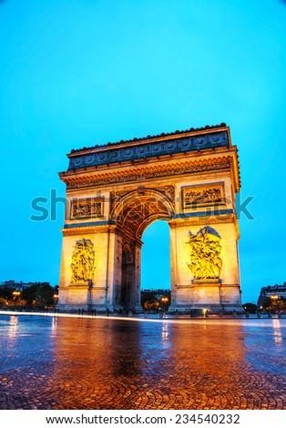 Arc de Triomphe de l'Etoile (The Triumphal Arch) in Paris in the morning - stock photo