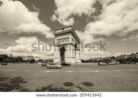 Arc de Triomphe in Paris. Etoile roundabout on a beautiful summer day. - stock photo