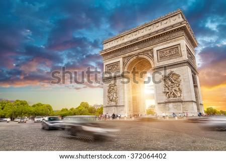 Arc de triomphe, Paris city at sunset  - stock photo