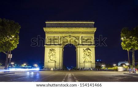 Arc de Triomphe, Paris, France at night. View from Avenue des Champs-Elysees - stock photo