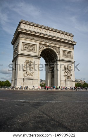 Arc de Triumph famous architecture  symbol of Paris - Charles de Gaulle square with beautiful monument by the day - stock photo